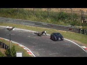 Porsche Cayman Driver Takes Out Nordschleife Biker?